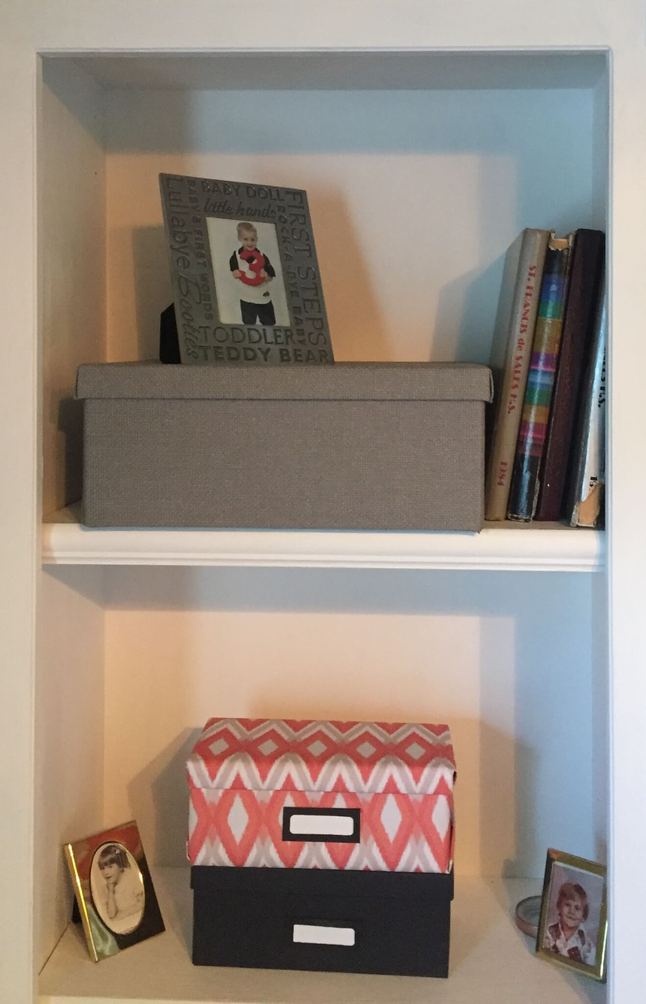 decorative containers and boxes on office bookshelves