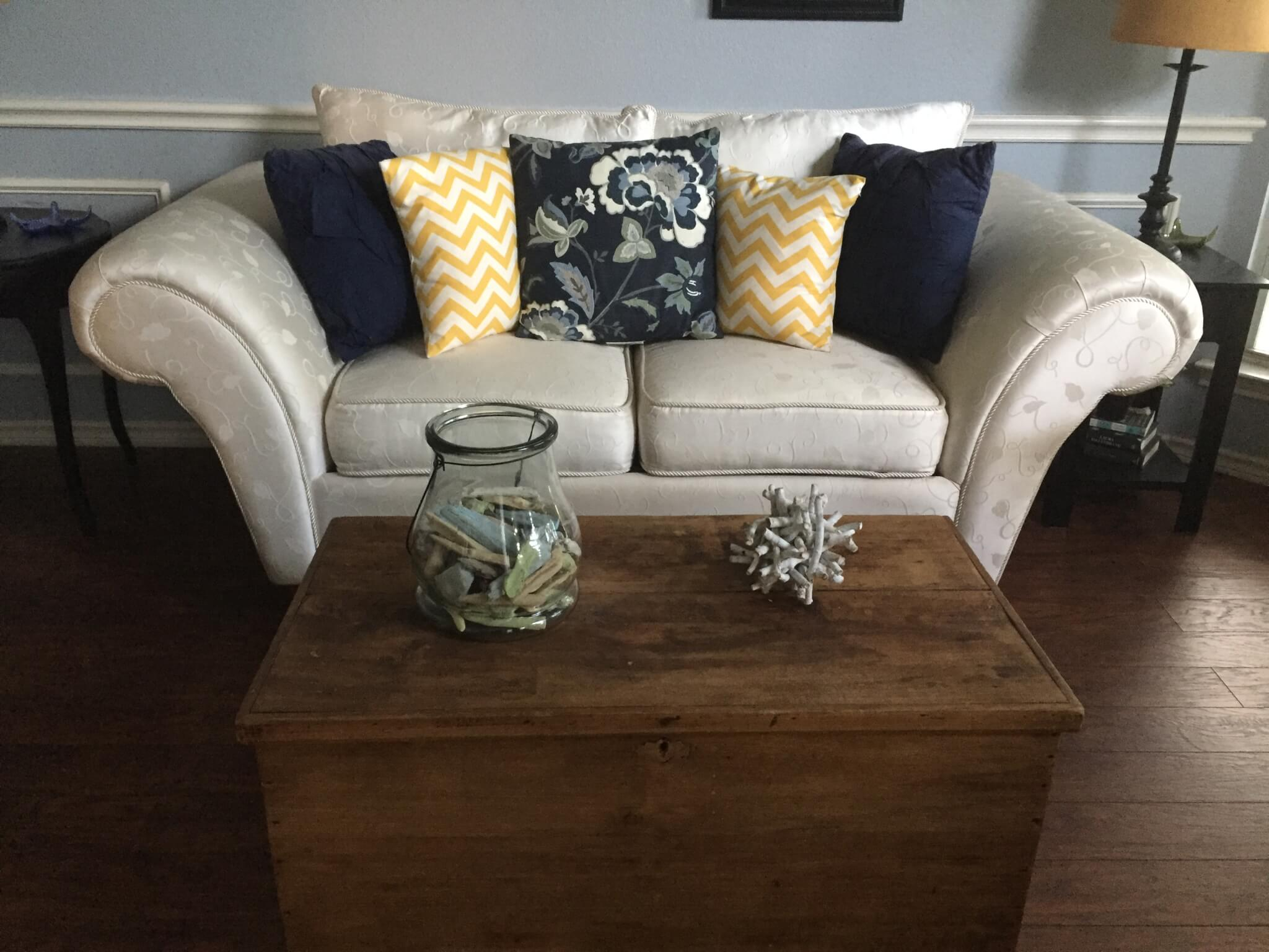 couch with chevron, floral, and solid throw pillow