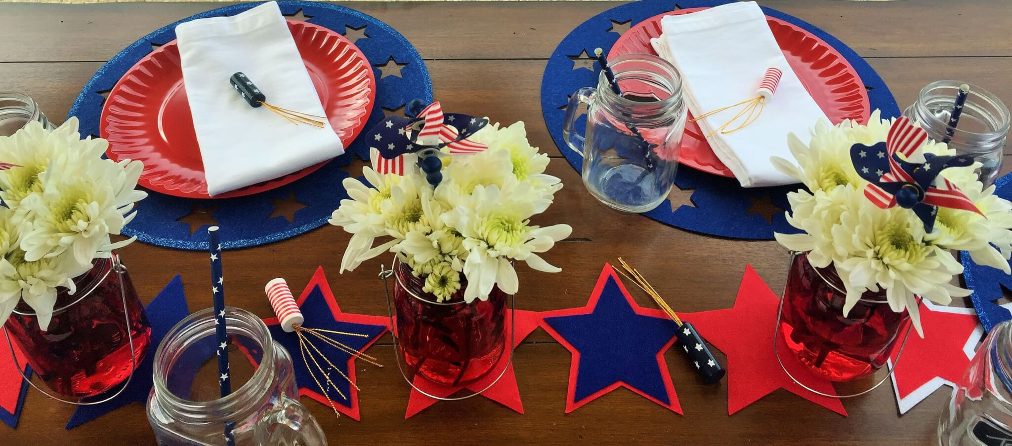 red mason jars used for centerpiece on patriotic tablescape
