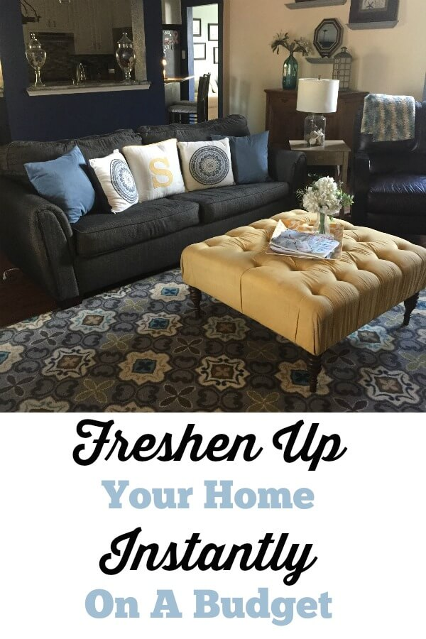 Family Room with Couch and throw pillows contains text overlay freshen up your home on a budget
