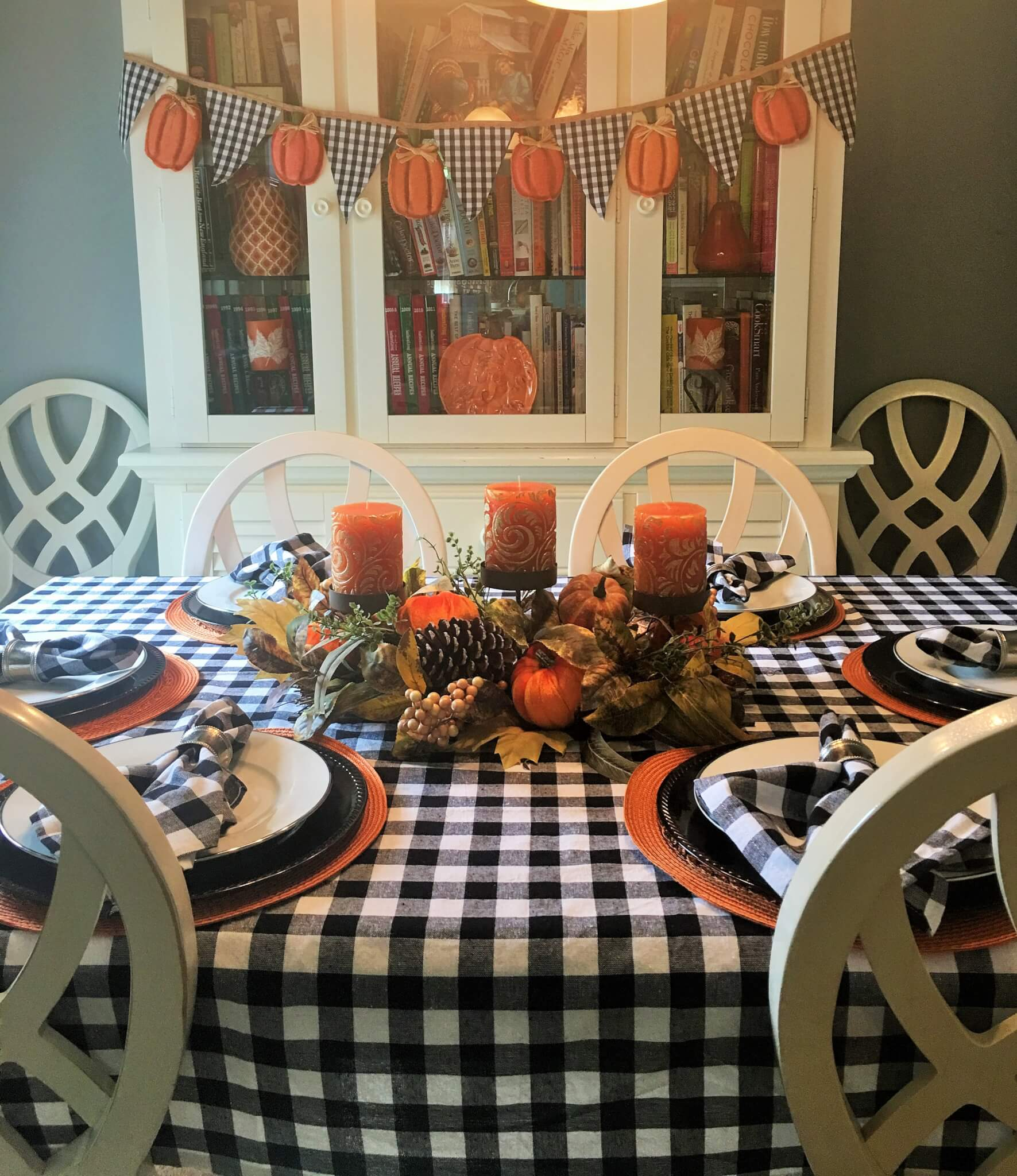 fall tablescape with traditional fall colors and buffalo check
