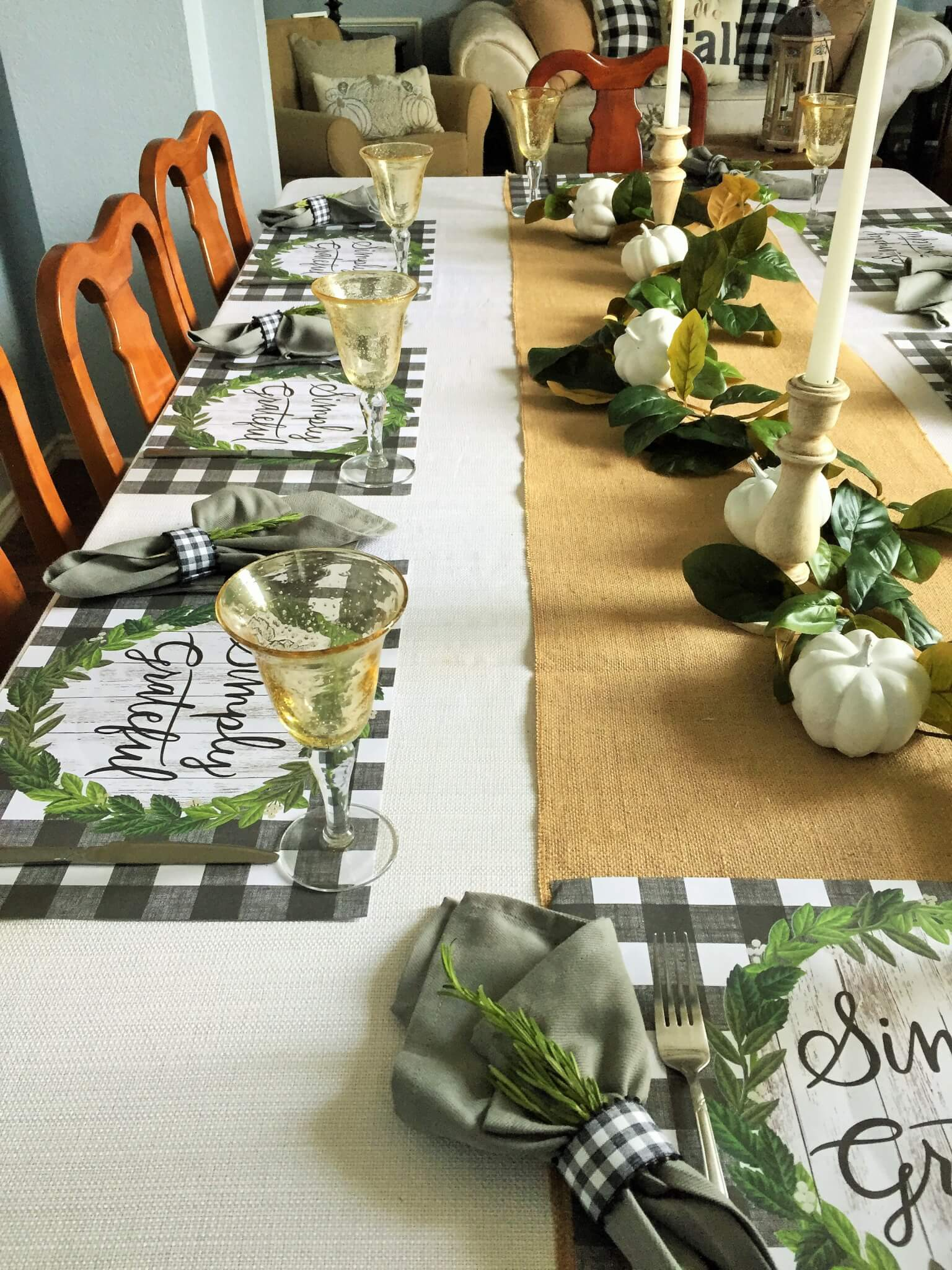 Fall tablescape with buffalo check place mats and magnolia leaf centerpiece