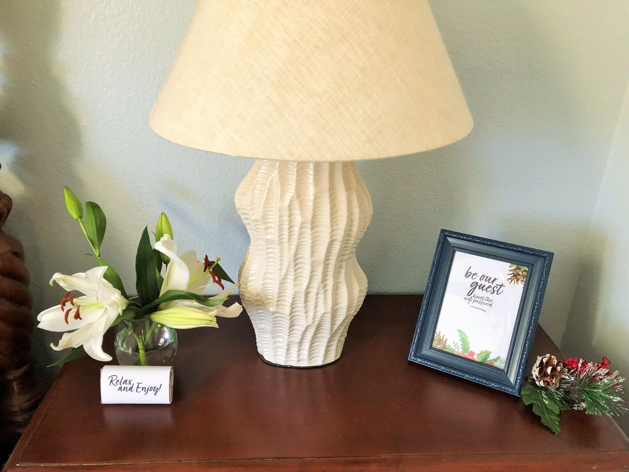 free wifi password on night stand with flowers for guest room