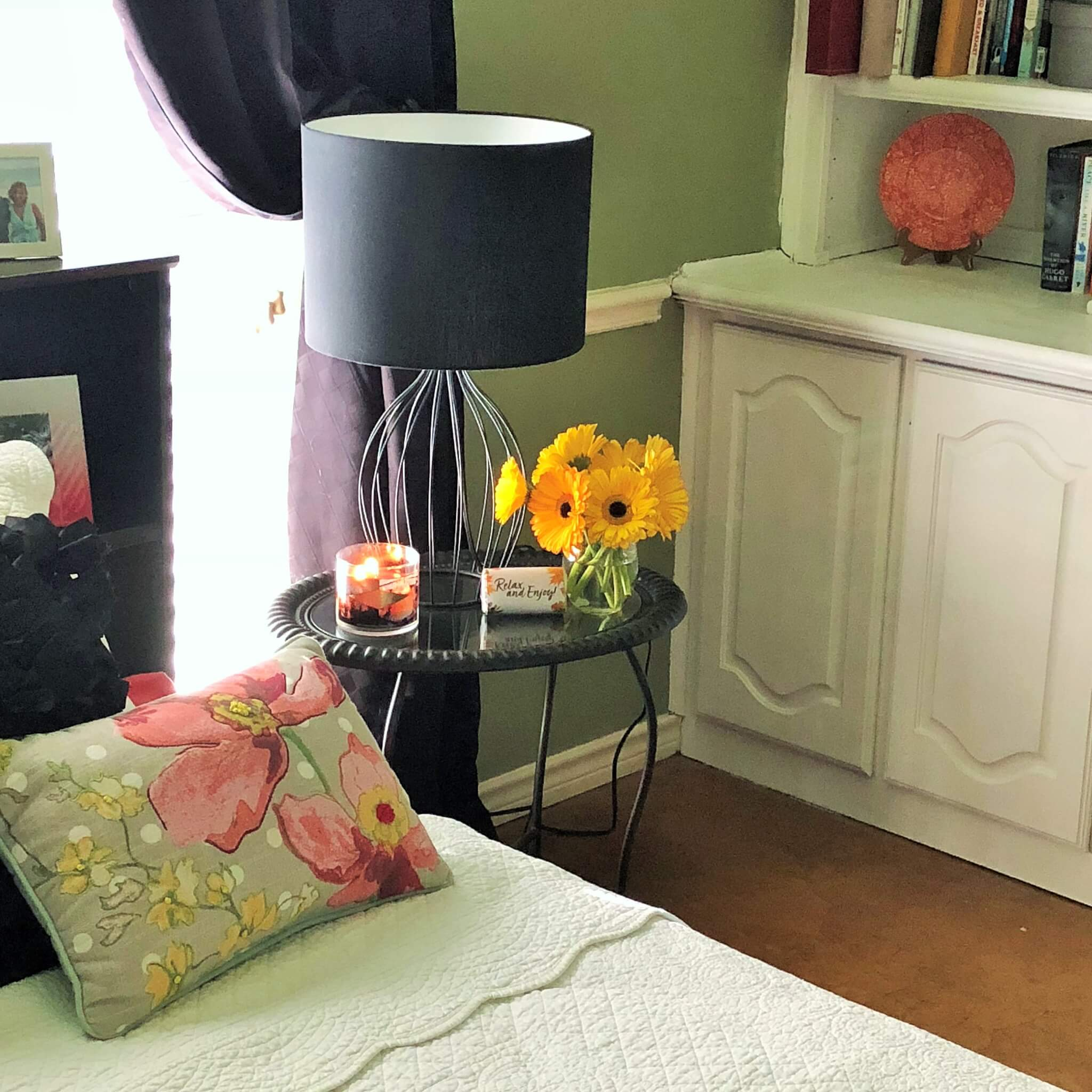 Guest room night stand with flowers and candle