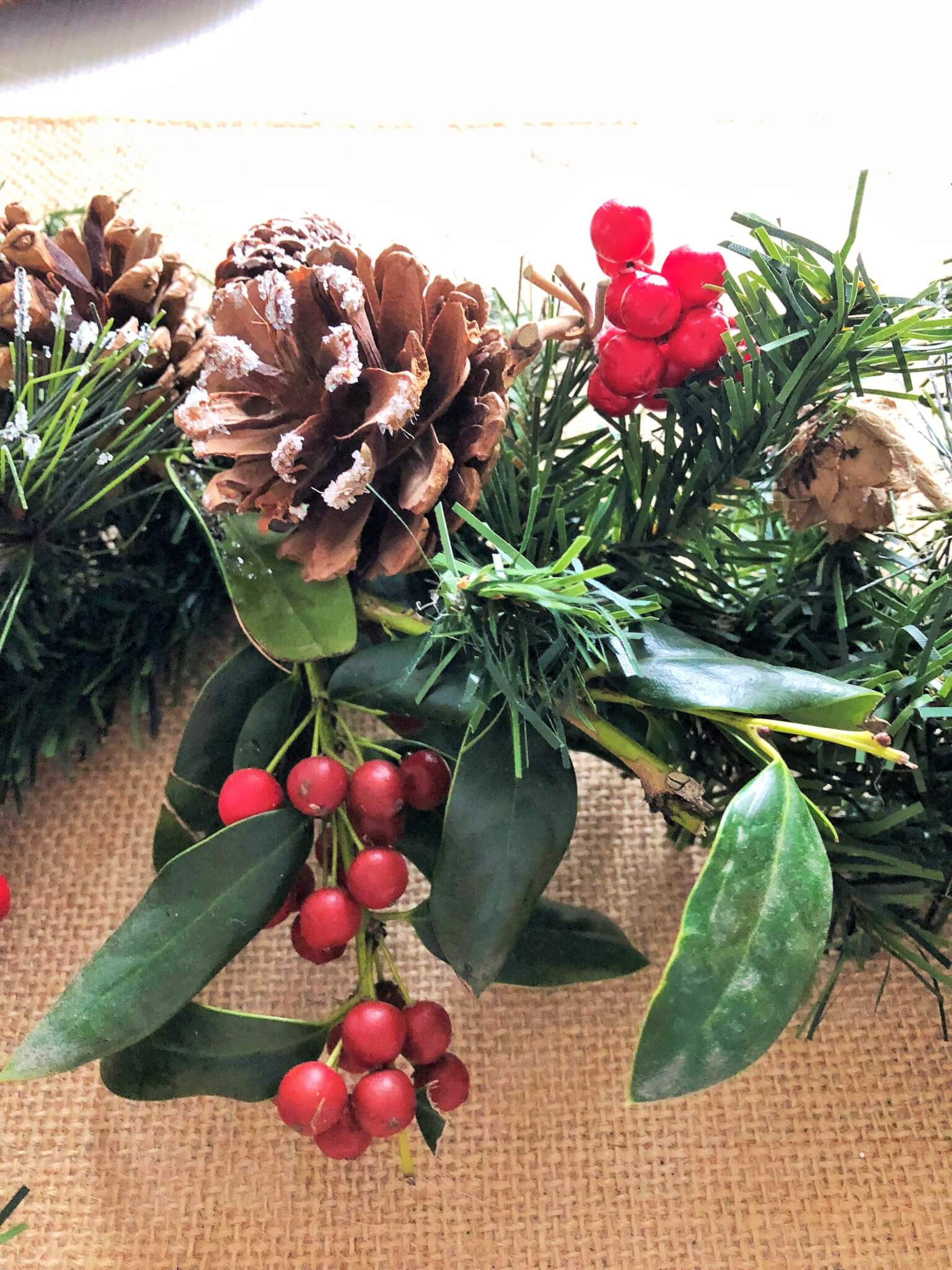 Fresh Holly Leave mixed with faux greenery