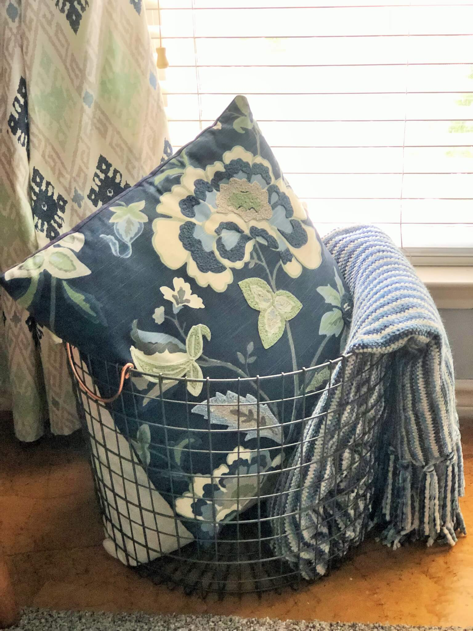 basket for guest room pillows and blankets