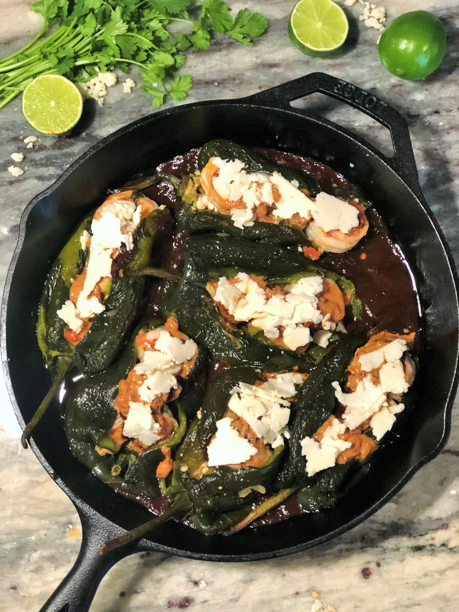 Cast Iron Skillet with Shrimp Chiles Rellenos before cooking