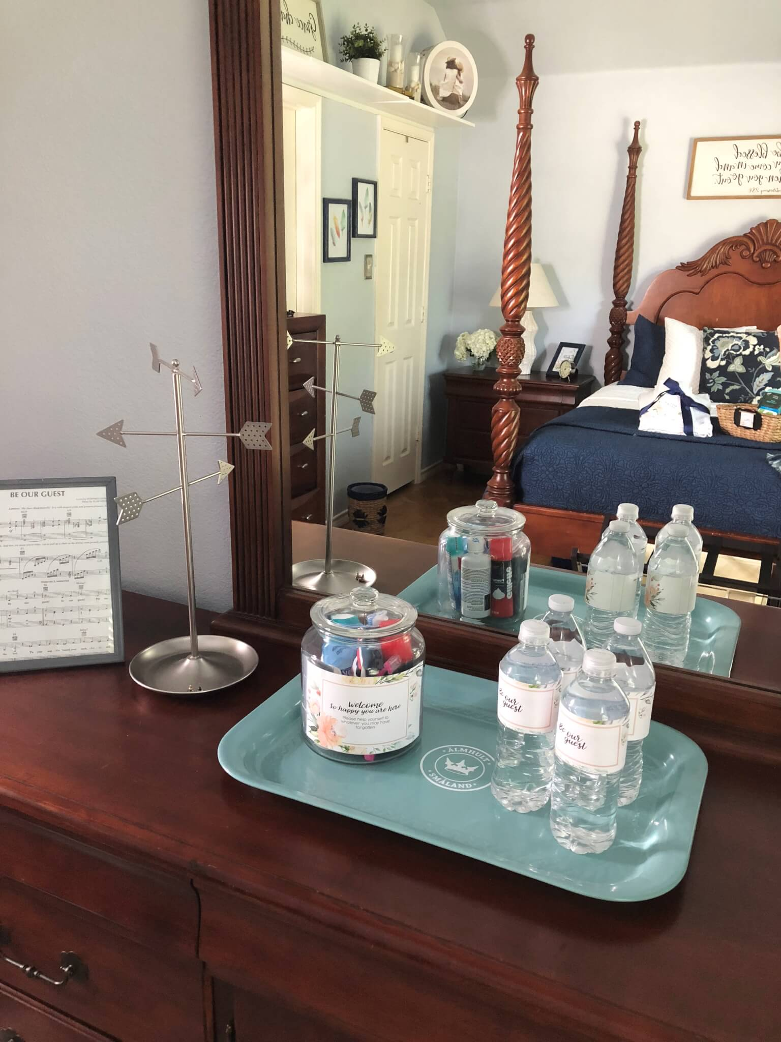 guest room dresser with tray for toiletries and water bottles