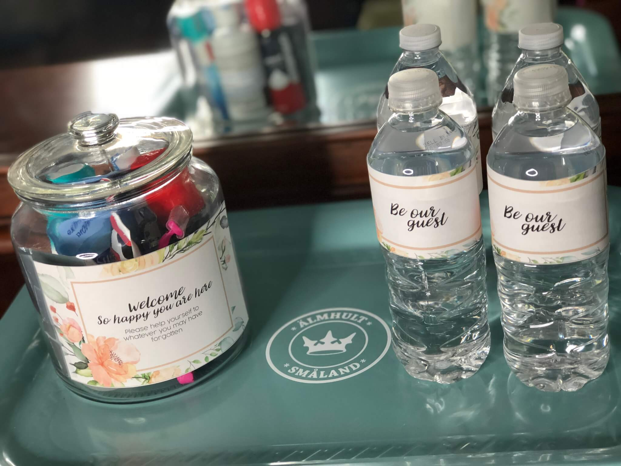 guest room tray with toiletries and water bottles