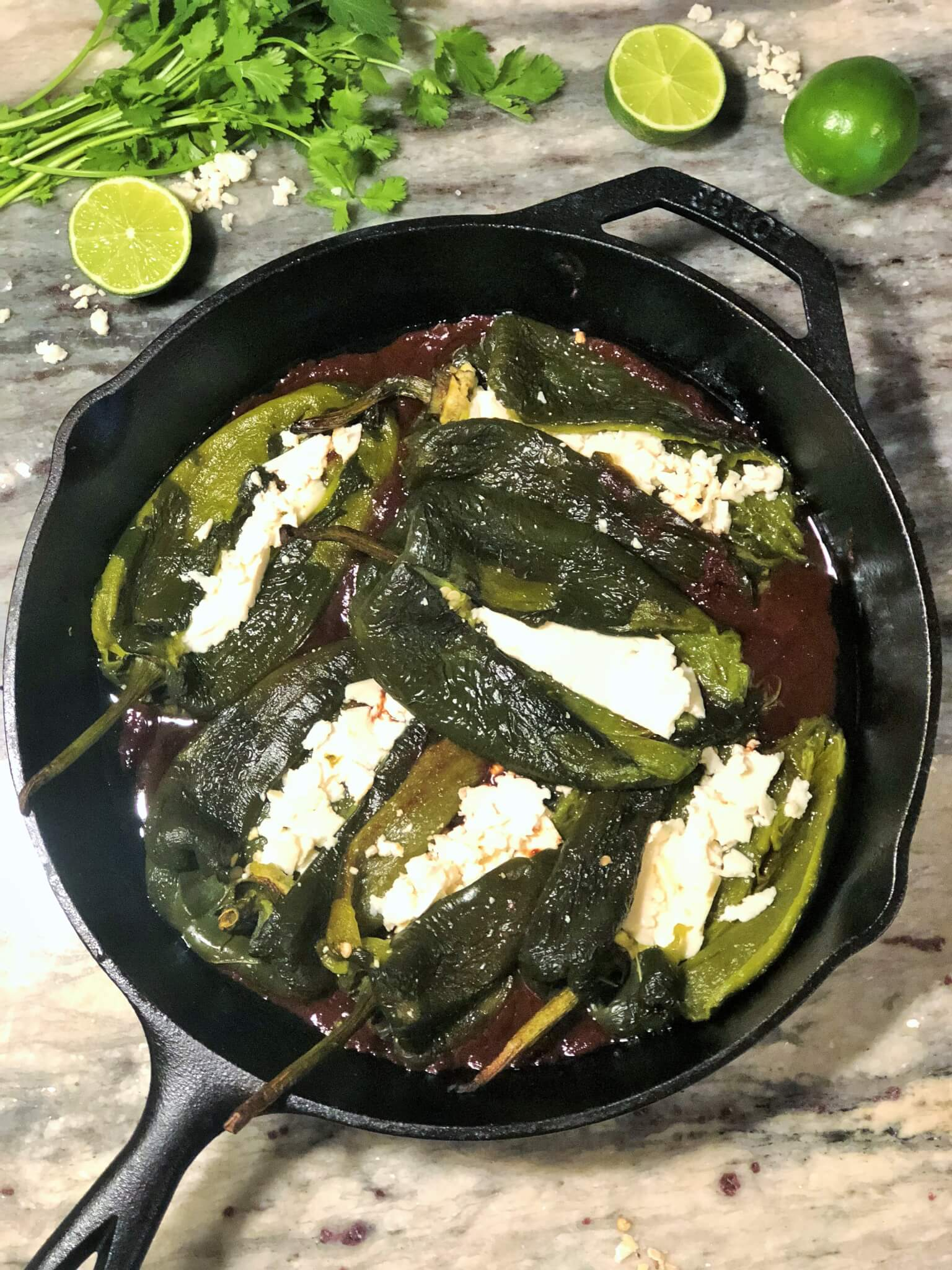 Cast iron pan with cheese chiles rellenos