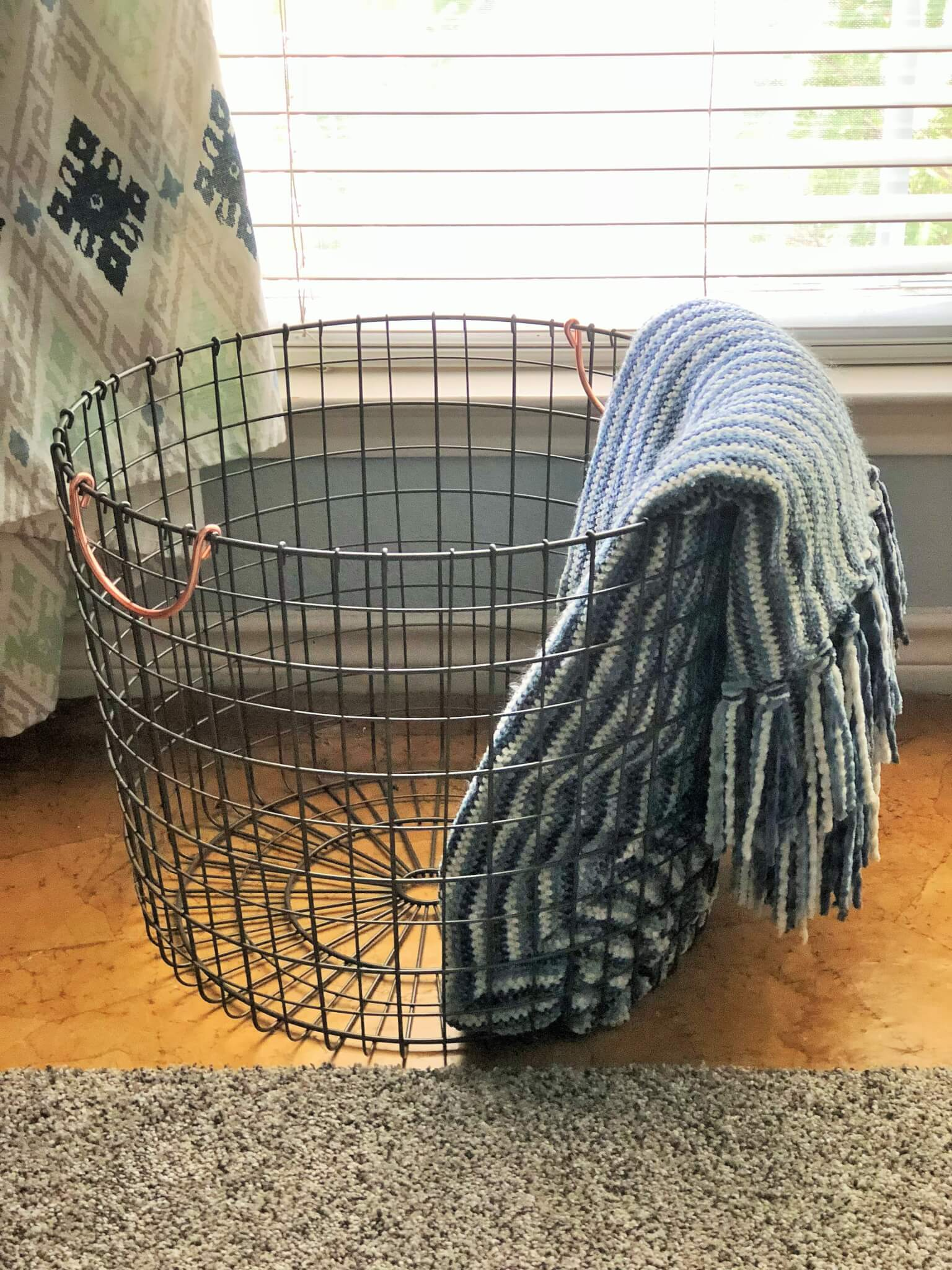 basket for guest room pillows and blanets