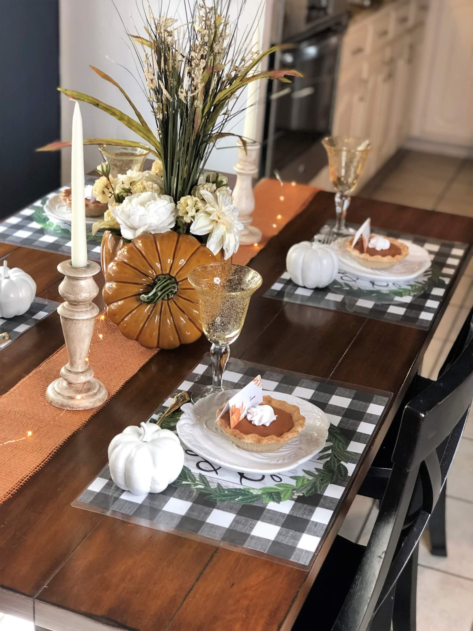 Fall Tablescape with buffalo check place mats and mini pumpkin pies