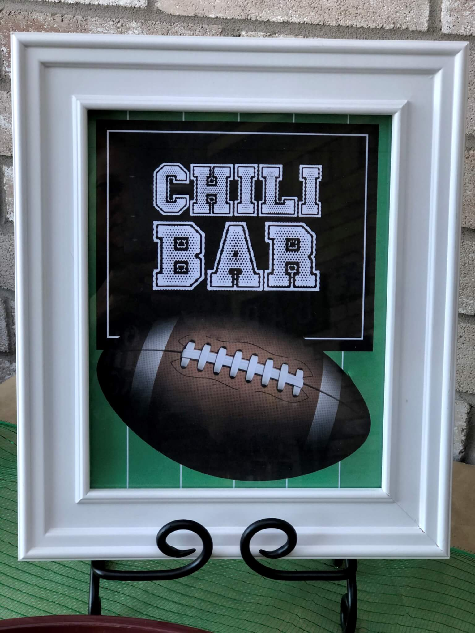 Creating a chili bar is a fun and easy way to host a gathering for any occasion. These ideas for toppings, decorations, sides, and more will help you to throw an epic chili party your guests will love. Free printables with multiple themes included! #chilibarparty #woodlandthemeparty #footballchilibar #smallgesturesmatter
