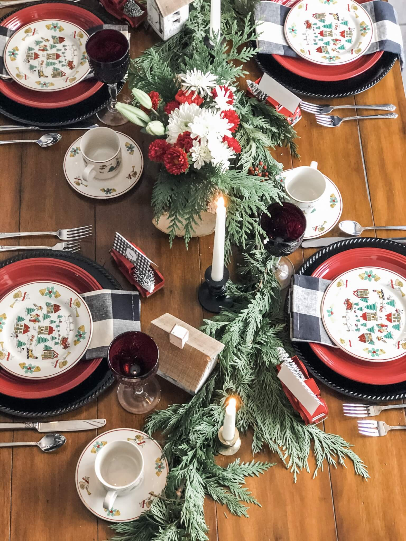 beautiful christmas tablescape with rustic and traditional elements including buffalo check
